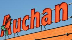 Soupçonée de fraude fiscale, la famille propriétaire du groupe Auchan visée par une série de