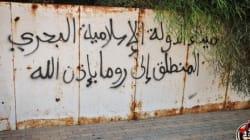 Scritte Isis sui muri di Sirte: