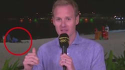 BBC Reporter Insists Couple Getting It On Behind Him Were 'Reading A