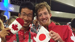 Evan Dunfee Poses With Japanese Rival And A Mitten, Warms