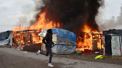 Migrants Set Fire To Calais Camp During