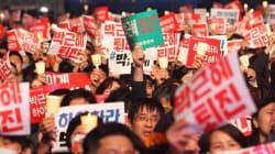 Imponente marcia contro la presidente Park stregata dalla