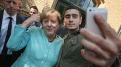 Si fa un selfie con la Merkel, rifugiato siriano denuncia Fb: