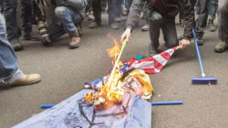 Montreal Protesters Cheer As They Set Fire To Donald Trump