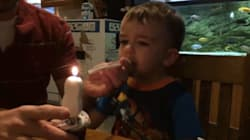 This Dad Showing His Son How To Blow Out A Candle Is Giving Us Parenting
