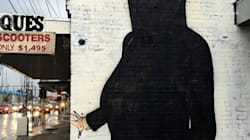 Street Artist Censors 'Offensive' Clinton Mural By Dressing Her In
