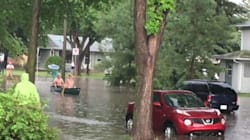 Saskatoon Men Canoe Around Flooded Homes Like It's