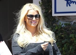 9b04fdd31156 LOOK  The Many Bags Of Jessica Simpson