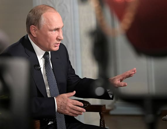 Putin deflects question on rivals' suspicious deaths