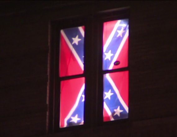 Man breaks apartment window with Confederate flag