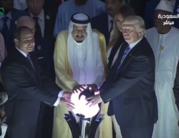 Photo shows Trump putting his hands on a glowing orb