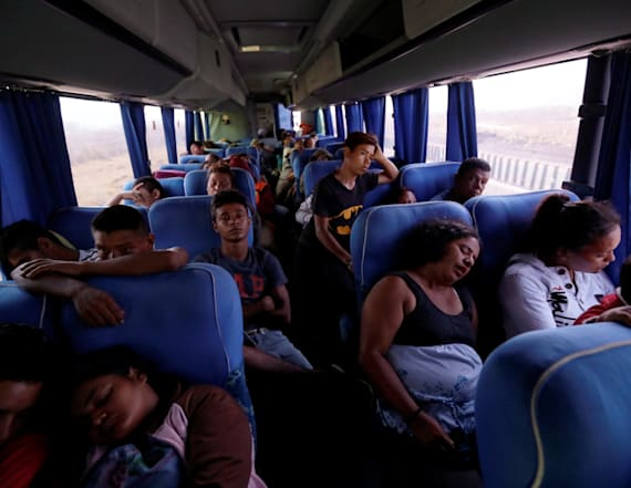 Busloads of 'caravan' migrants arrive at border