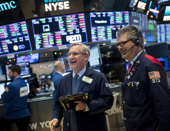 Dow ends above 26,000 for first time