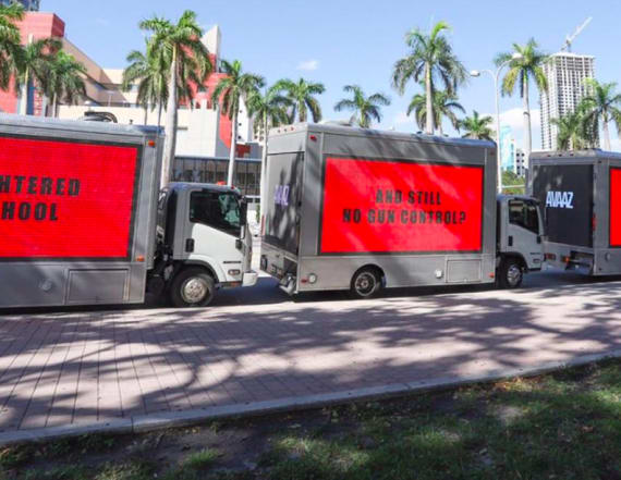 3 billboards grill Rubio outside of his Miami office