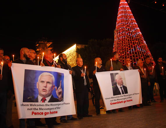 Palestinian protesters set Mike Pence images on fire