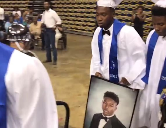 Family accepts student's diploma after he is killed