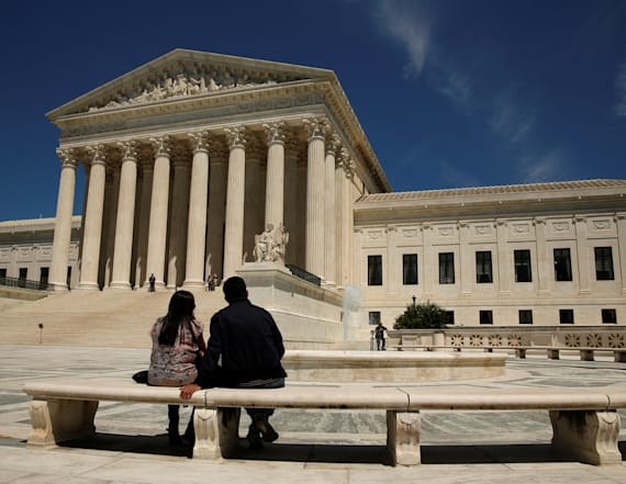Supreme Court takes up fight over Trump travel ban
