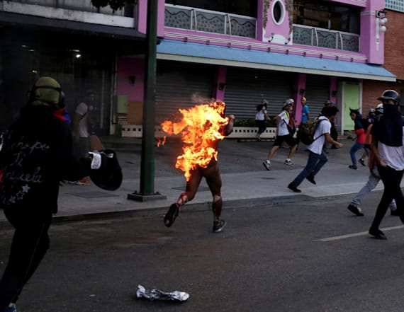 Man set on fire during Venezuela protests