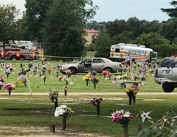 Man arrested after plowing car into cemetery crowd
