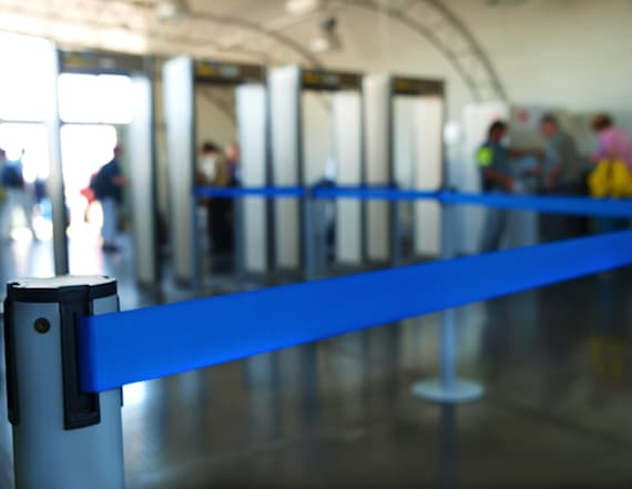 Do this at airport security to cut your wait in half