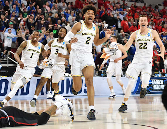 Michigan stays alive with dramatic buzzer-beater