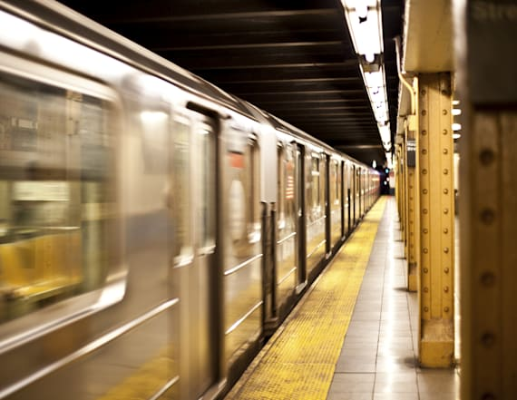 Man pushes woman onto NYC subway tracks