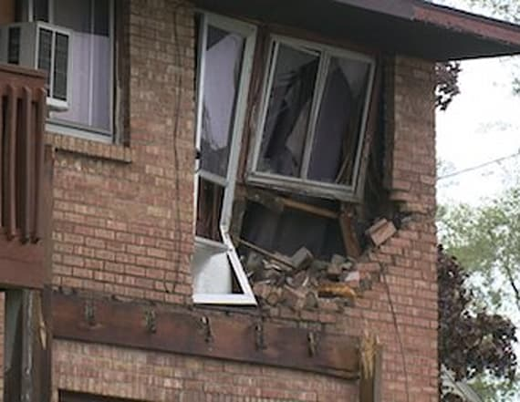 Car accident throws vehicle into second-story window