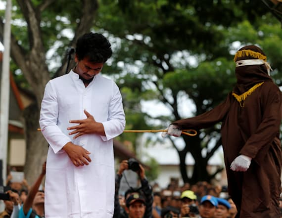Men publicly caned for having gay sex