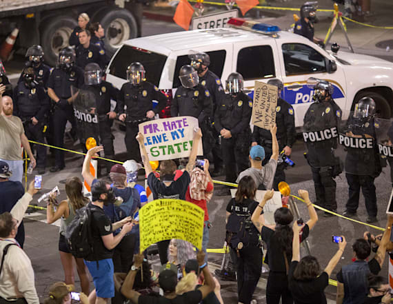 Police pepper spray protesters at Trump rally