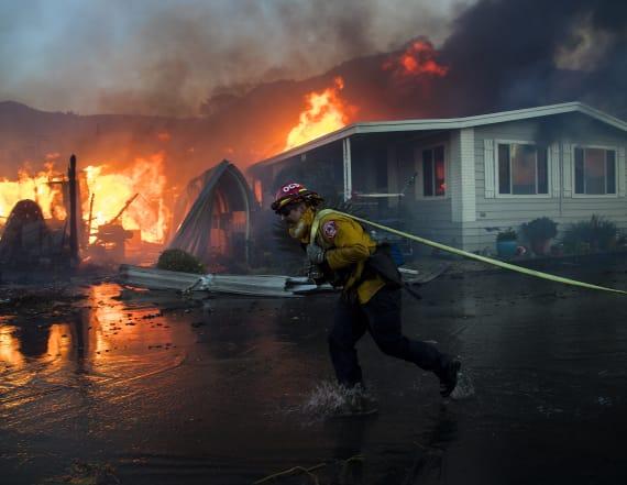 Dramatic photos show firefighters battling blaze
