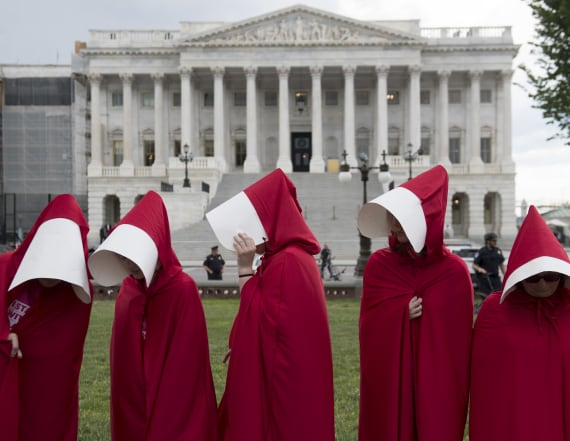 Group stages 'Handmaid's Tale'-inspired protest
