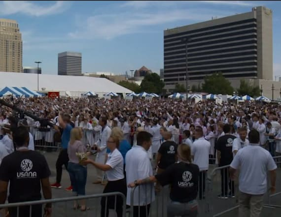 Thousands gather in lab coats to set world record