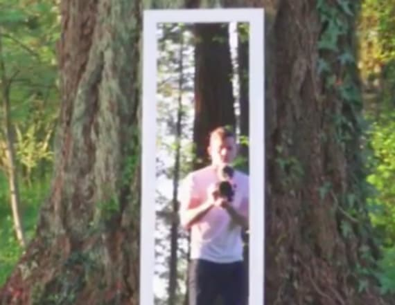 Illusion video shows man walking through mirror
