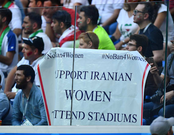 Woman blocked from bringing banner to World Cup game