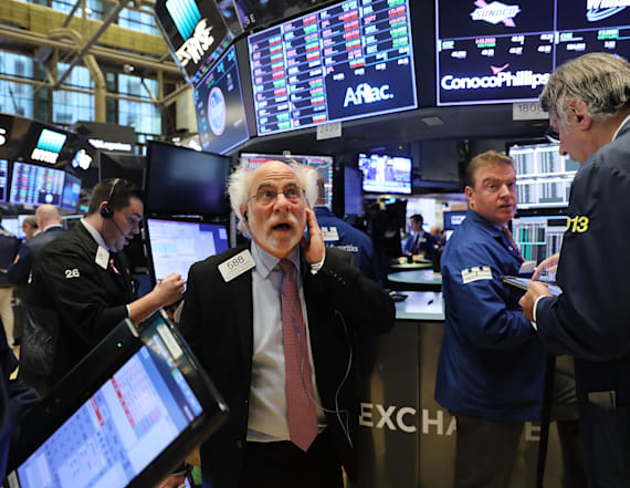 Dow cracks 23,000 mark for the first time