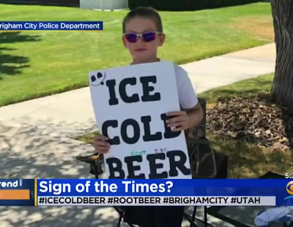 Boy advertises 'Ice Cold Beer' at root beer stand