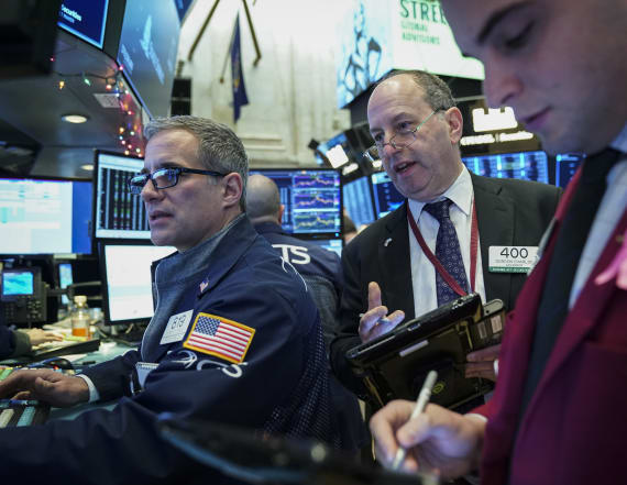 Wall Street ends choppy session higher