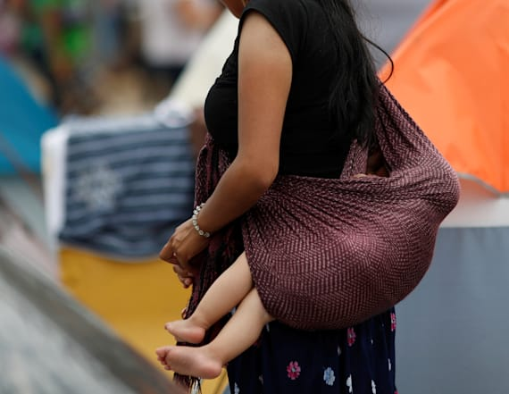 Migrant mothers and children sue over asylum ban