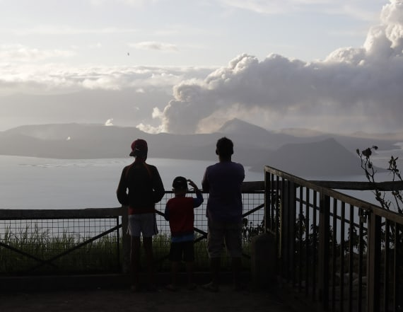 Taal volcano emits ash, threatening more eruption
