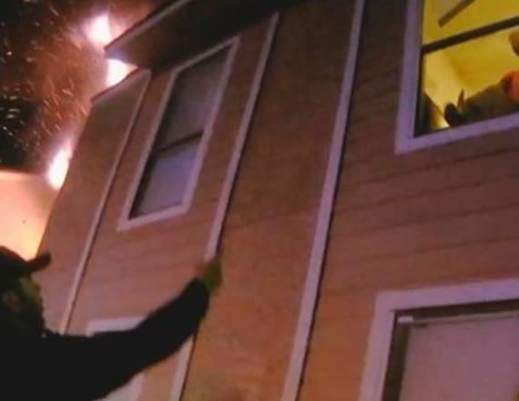 Little boy jumps from fiery second story apartment
