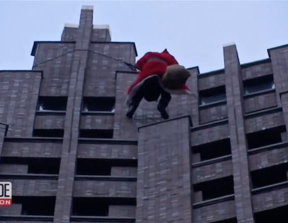 Santa repels down skyscraper to surprise children
