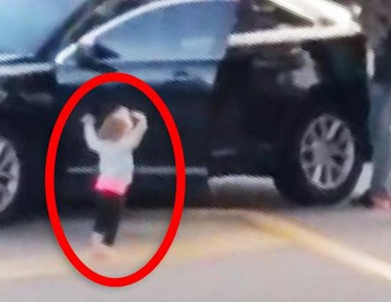 2-year-old puts her hands up for the cops