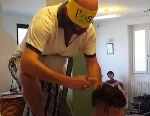 Barber performs haircuts blindfolded