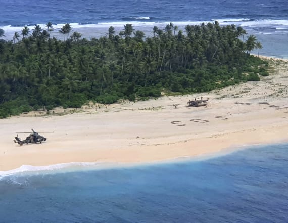 Men rescued from island after writing SOS in sand