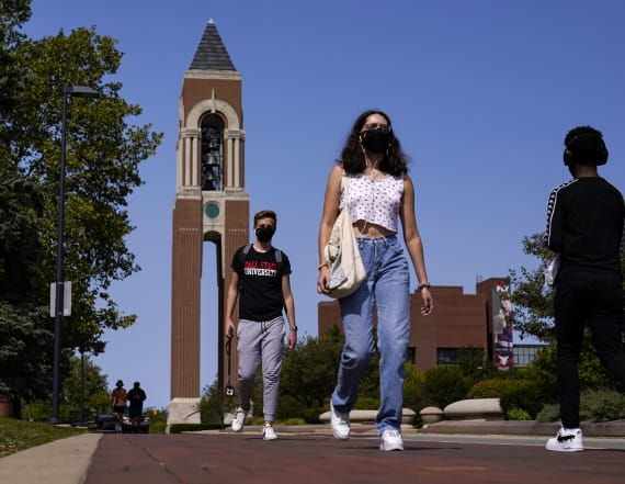 Virus rates soar in college towns as students return