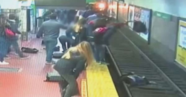 Bystanders rush to rescue woman who fell onto subway tracks