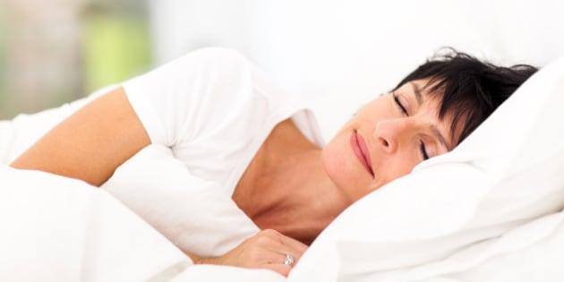cute mature woman sleeping on...