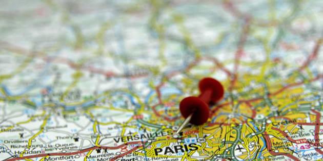 red push pin pointing at paris  ...