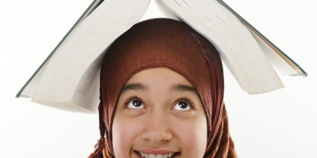 female arabic student balancing ...