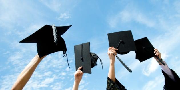 many hand holding graduation...